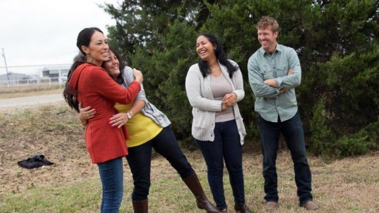 Chip and Joanna Gaines hugging homebuyer