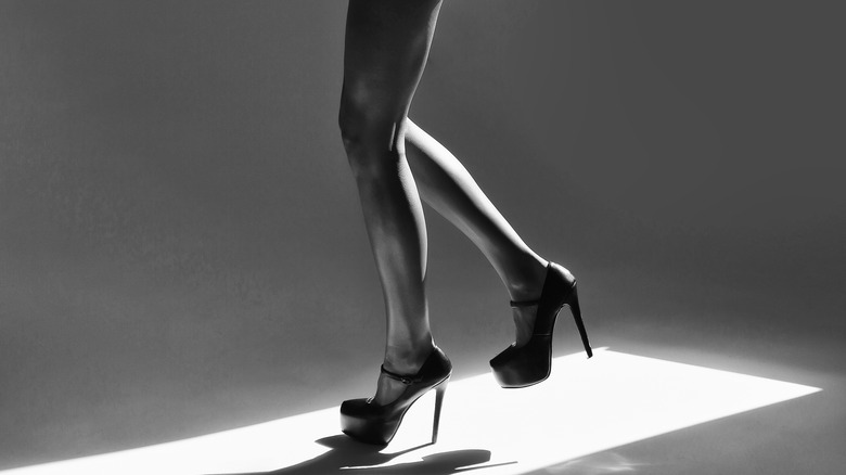 woman with long legs wearing heels
