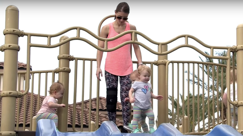 Danielle Busby outside with her kids