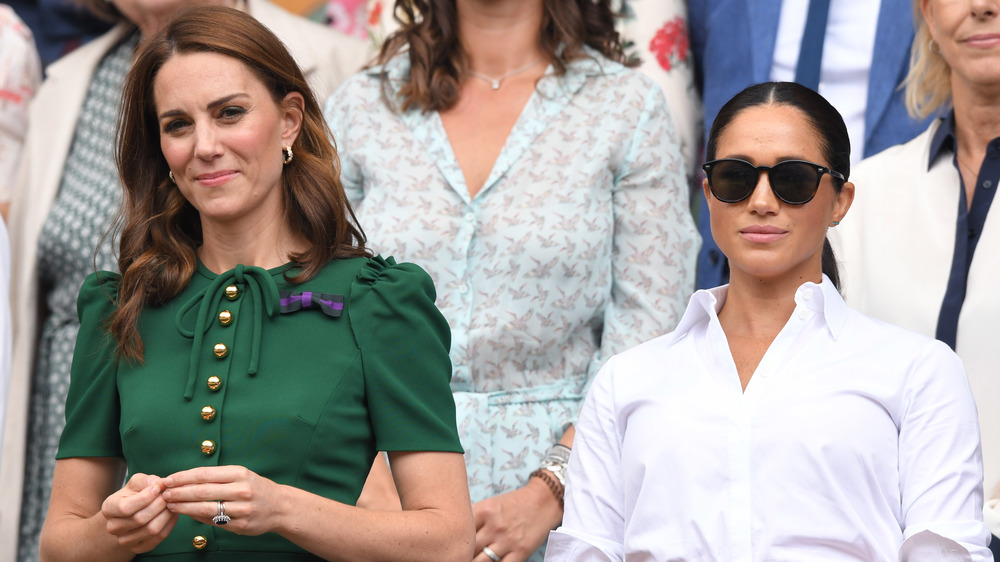 Kate Middleton and Meghan Markle at an event