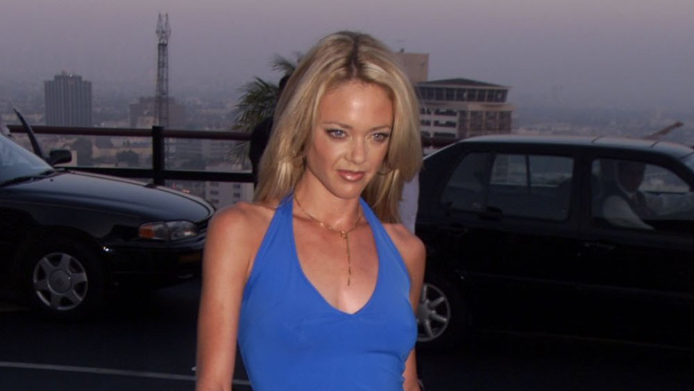 Lisa Robin Kelly in front of cars in a city