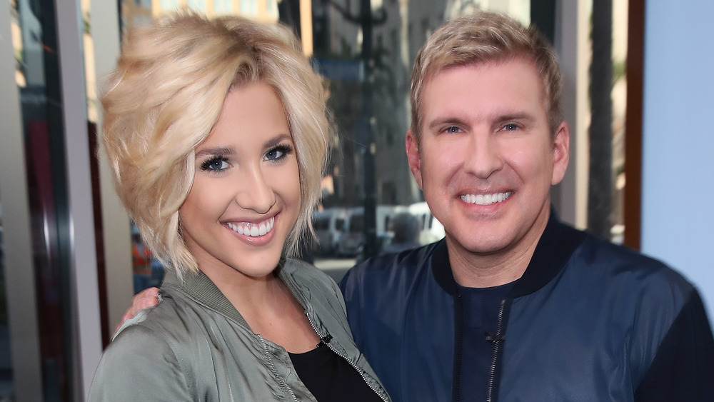Todd and Savannah Chrisley outside of a building