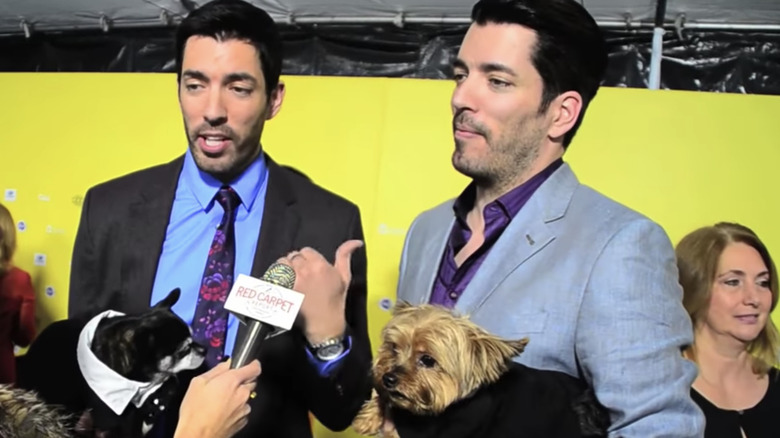 Property Brothers Jonathan Scott and Drew Scott with Jonathan's dogs