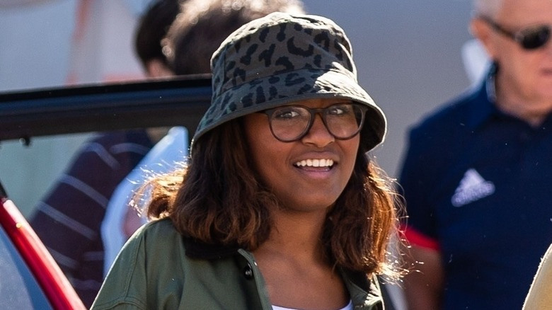 Sasha Obama wearing a hat and jacket