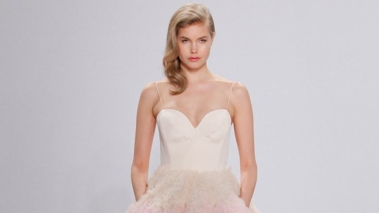 cb49f0202c197 Most brides featured on Say Yes to the Dress leave with long white dresses,  and while eyebrows definitely get raised when brides come in searching for  ...