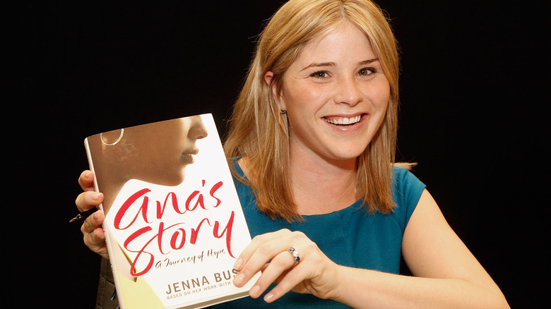 Jenna Bush Hager holding up her first book