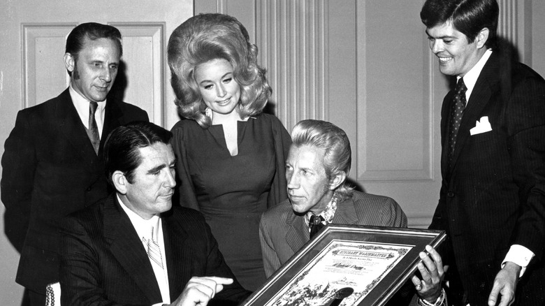 Dolly Parton and several men with Porter Wagoner