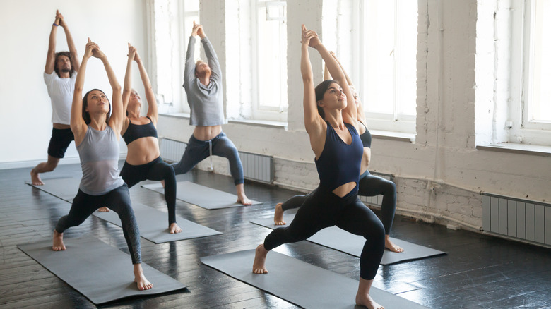 A group of young people doing yoga