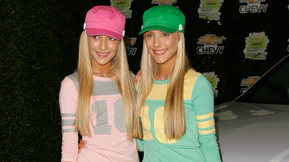The Rosso twins wearing coordinated sporty outfits