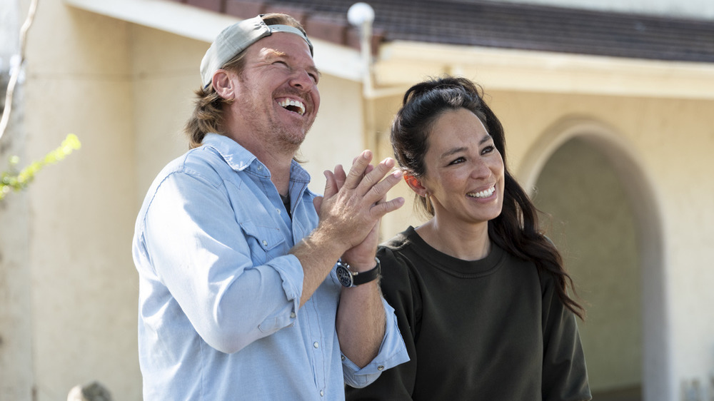 Chip and Joanna Gaines on Fixer Upper, smiling