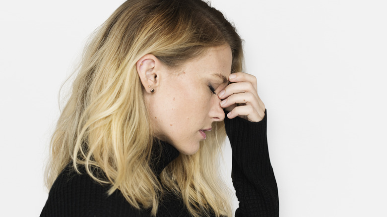 stressed woman with acne