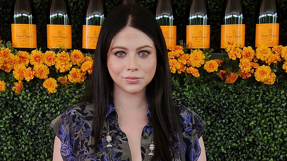 Michelle Trachtenberg on a red carpet in 2015