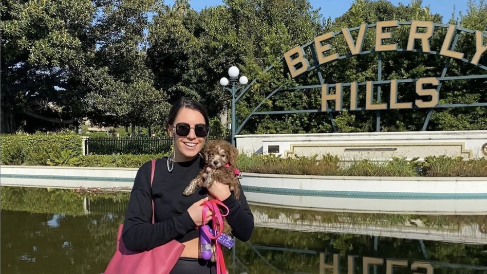 Victoria Larson with a dog in Beverly Hills