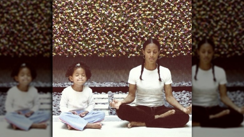 Young Willow Smith meditating with mom Jada Pinkett Smith